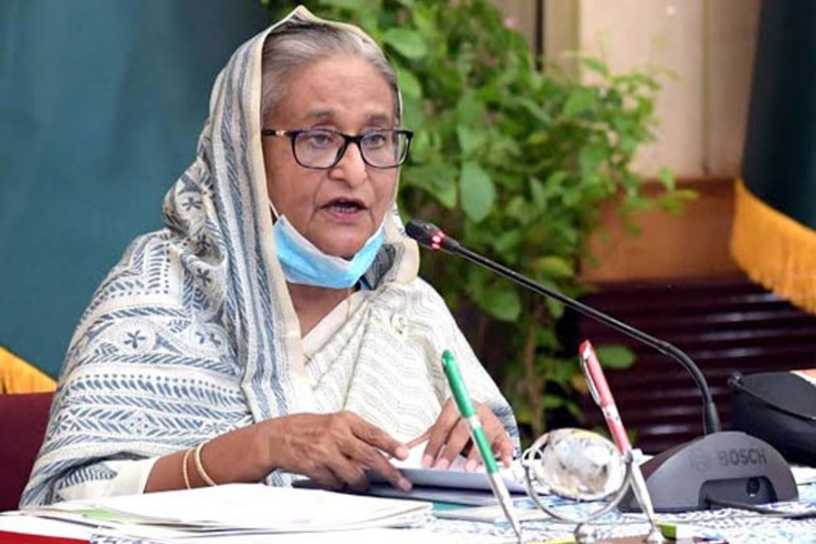 Prime Minister Sheikh Hasina joins the weekly ECNEC meeting virtually from her official residence Ganabhaban. Photo source: BSS