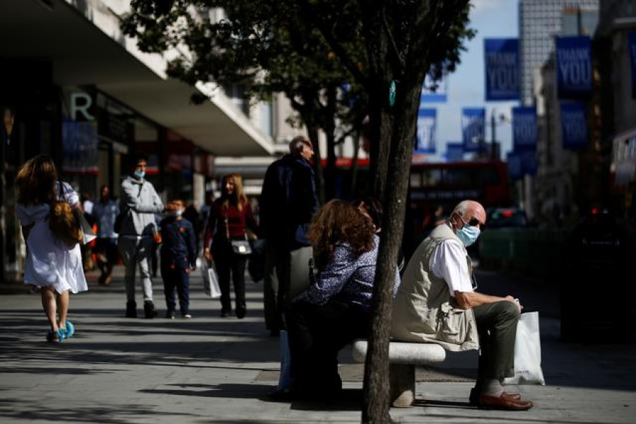 A man wearing a protective face mask sits on a bench on Oxford Street, amid the coronavirus disease (Covid-19) outbreak, in London, Britain on September 17, 2020 — Reuters/Files
