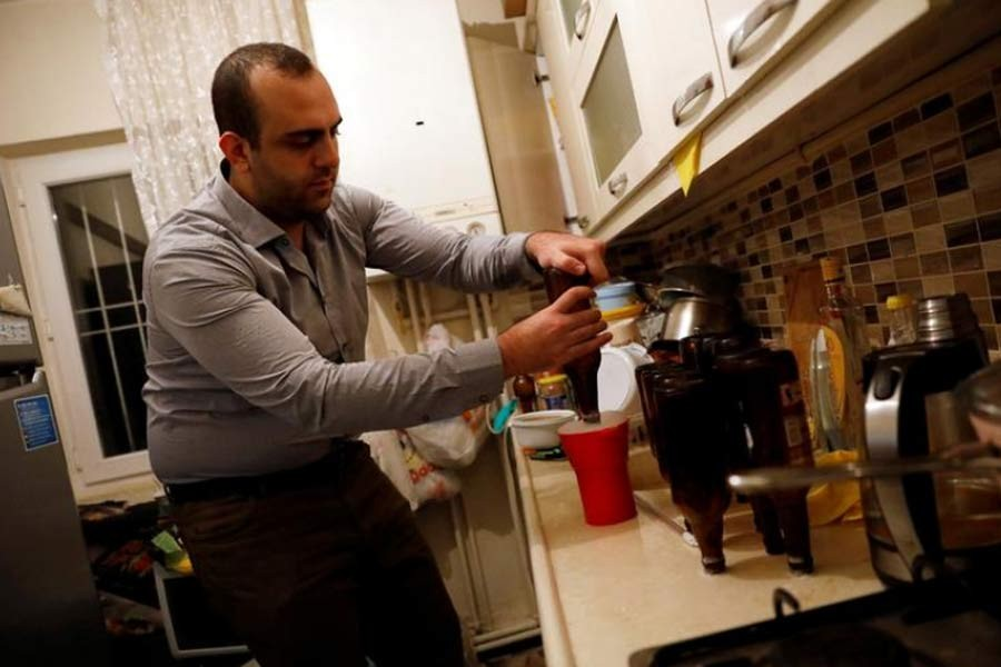 Onder Ceyhan, a 25-year old university student, is preparing his own beer at his home in Ankara. The photo was taken in 2017. –Reuters file photo