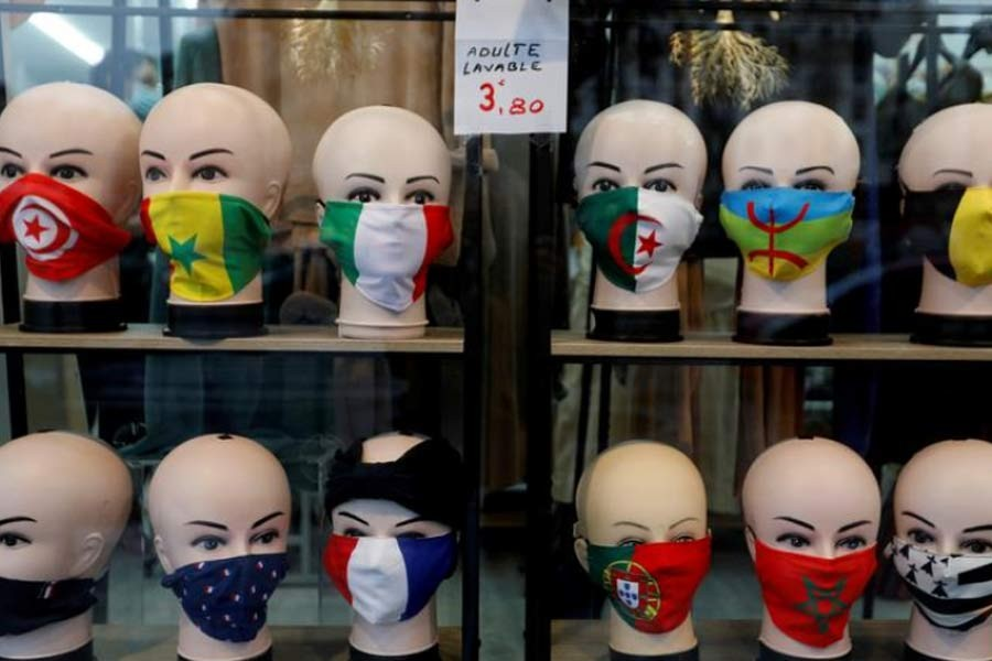 Protective face masks with flags design are seen on display in a shop in Paris, as the coronavirus disease (COVID-19) outbreak continues in France. The photo was taken on Tuesday. –Reuters Photo