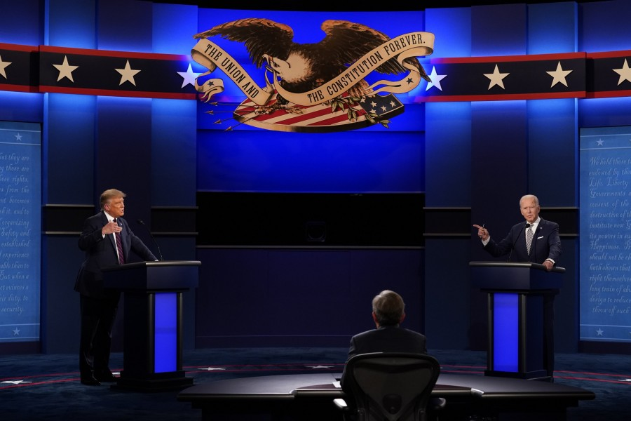 US President Donald Trump, left, and Democratic presidential candidate former Vice President Joe Biden, right, with moderator Chris Wallace of Fox News during the first presidential debate at Case Western University and Cleveland Clinic, in Cleveland, Ohio, US on September 29, 2020 — AP/Files