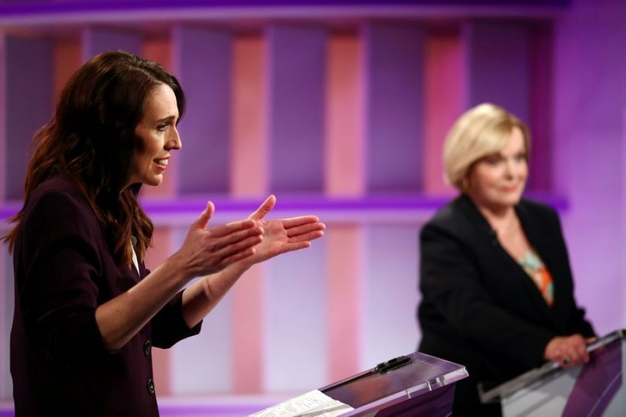 New Zealand Prime Minister Jacinda Ardern (L) and National leader Judith Collins participate in a televised debate at TVNZ in Auckland, New Zealand, September 22, 2020. Fiona Goodall/Pool via REUTERS