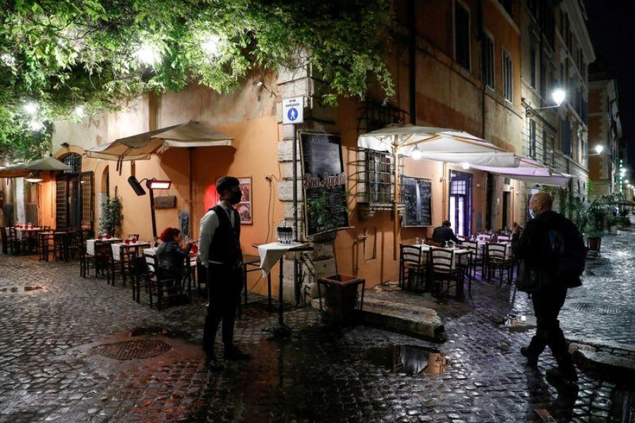 Empty tables are seen outside a restaurant in Rome as the country tightens regulations in an effort to control rising Covid-19 infections, Rome, Italy on October 14, 2020 — Reuters photo