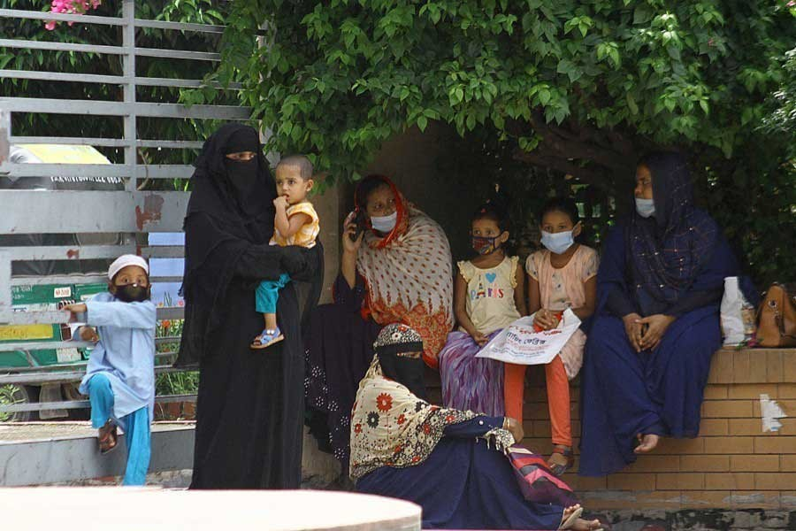 Women waiting with their children for Covid-19 test at Mugda General Hospital in the capital recently —File photo