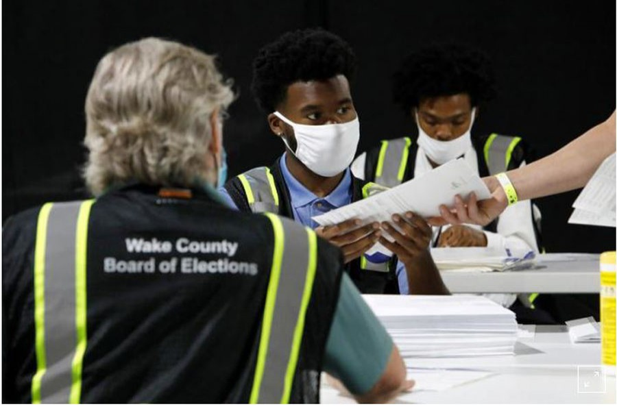 FILE PHOTO: Poll workers prepare absentee ballots for shipment at the Wake County Board of Elections on the first day that the state started mailing them out, in Raleigh, North Carolina, U.S. September 4, 2020. REUTERS/Jonathan Drake