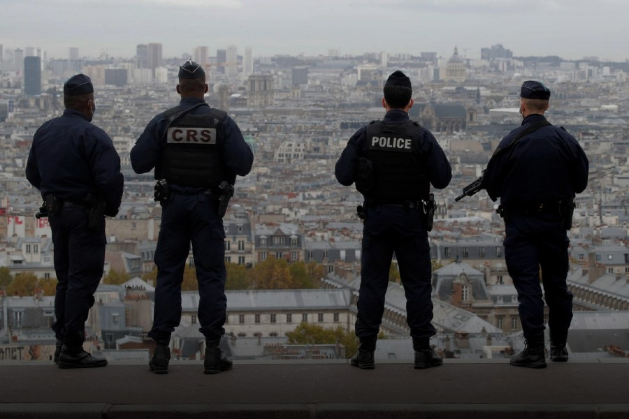 French police and CRS riot policemen patrol in Montmartre in Paris as France has raised the security alert for French territory to the highest level after the knife attack in the city of Nice, France, October 30, 2020. REUTERS/Charles Platiau