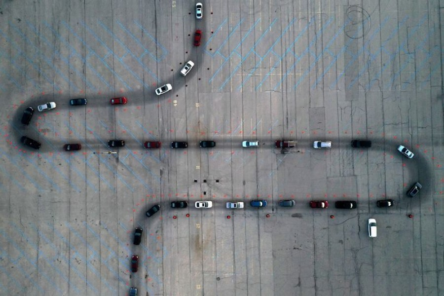An aerial view of vehicles waiting at a drive-thru Covid-19 testing site in the parking lot of Miller Park, as the coronavirus (Covid-19) disease outbreak continues in Milwaukee, Wisconsin, US on November 5, 2020. Picture taken with a drone — Reuters/Files