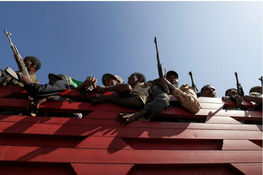 FILE PHOTO: Members of Amhara region militias ride on their truck as they head to the mission to face the Tigray People's Liberation Front (TPLF), in Sanja, Amhara region near a border with Tigray, Ethiopia November 09, 2020. REUTERS/Tiksa Negeri//File Photo