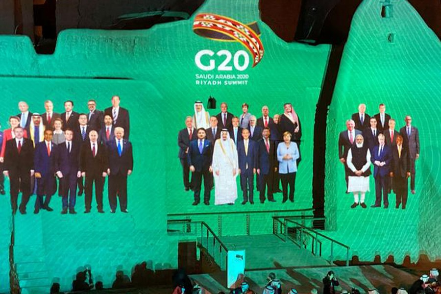 """""""Family Photo"""" for annual G20 Summit World Leaders is projected onto Salwa Palace in At-Turaif, one of Saudi Arabia's UNESCO World Heritage sites, in Diriyah, Saudi Arabia on November 20, 2020 — Reuters photo"""