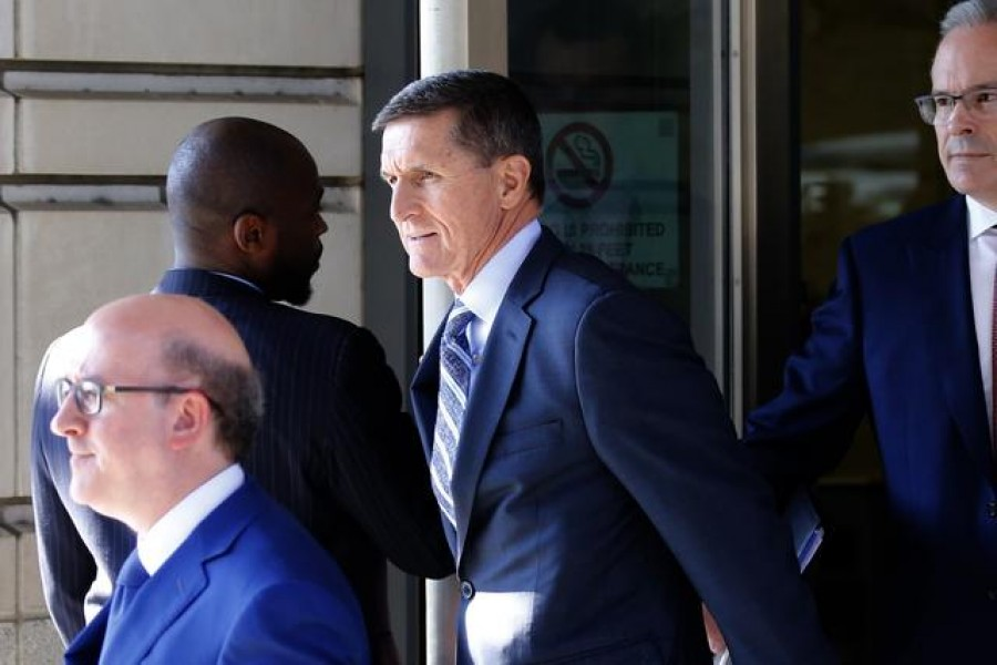 Former U.S. National Security Adviser Michael Flynn departs US District Court, where he was expected to plead guilty to lying to the FBI about his contacts with Russia's ambassador to the United States, in Washington, US, December 1, 2017. REUTERS/Jonathan Ernst