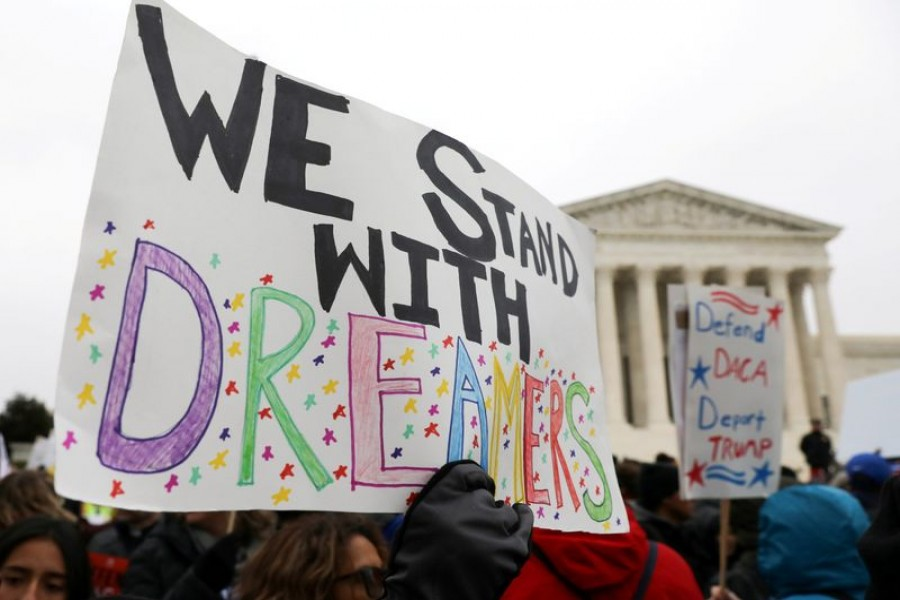 Demonstrators rally outside the U.S. Supreme Court as justices were scheduled to hear oral arguments in the consolidation of three cases before the court regarding the Trump administration's bid to end the Deferred Action for Childhood Arrivals (DACA) program in Washington, US, November 12, 2019. REUTERS/Jonathan Ernst/File Photo