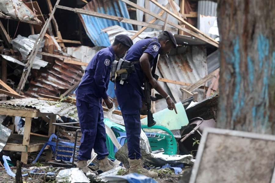 Somali policemen at the scene of a suicide explosion at a restaurant near a police academy in Mogadishu of Somalia on November 17 –Reuters file photo