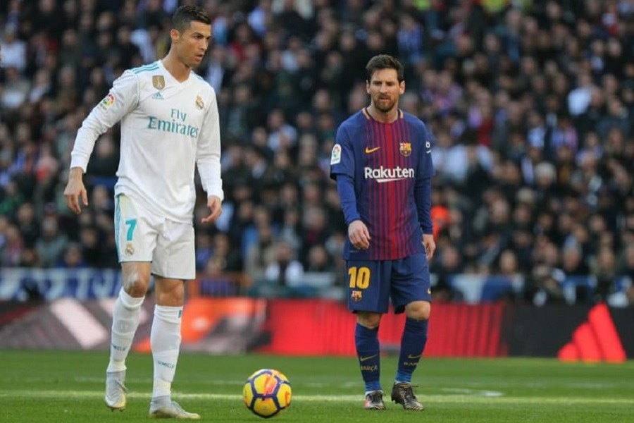 Football - La Liga Santander - Real Madrid vs FC Barcelona - Santiago Bernabeu, Madrid, Spain - December 23, 2017 Real Madrid's Cristiano Ronaldo in action with Barcelona's Lionel Messi — Reuters/Files
