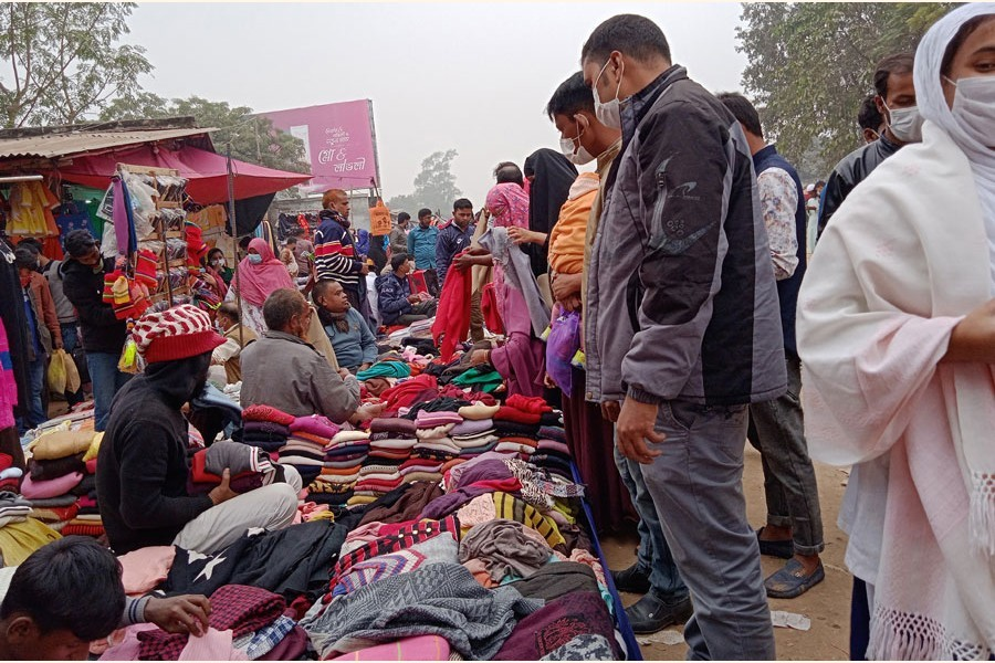 Buyers purchasing winter clothes at Hawker Market under sadarupazila in Bogura. The photo was taken on Thursday — FE Photo