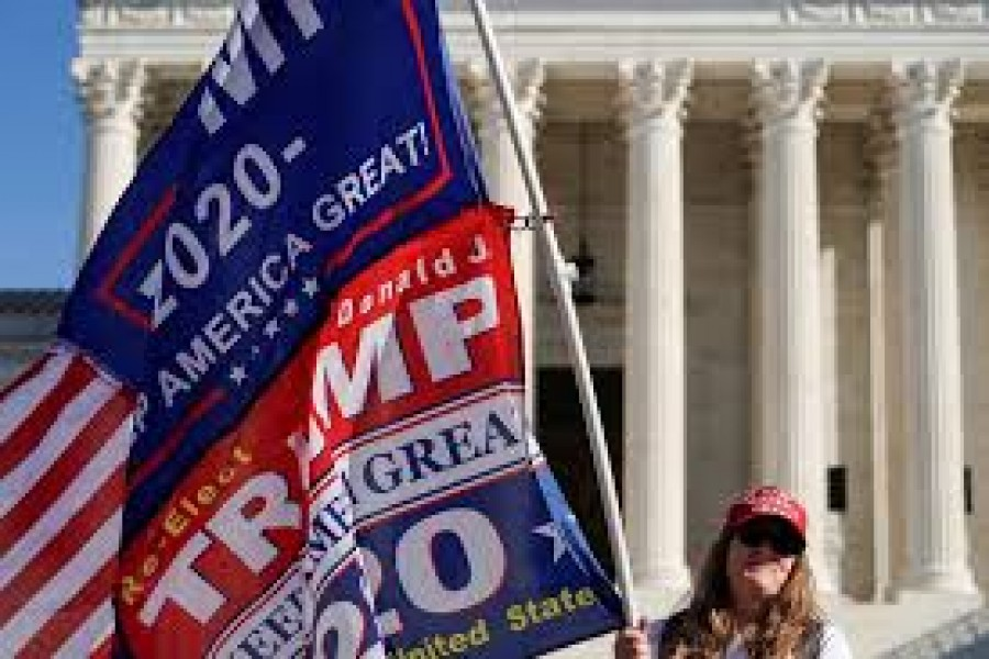 Kathleen Kratt, of Orlando, Florida, and a supporter of US President Donald Trump holds a flag in front of the Supreme Court as the court reviews a lawsuit filed by Texas seeking to undo President-elect Joe Biden's election victory in Washington, US, December 11, 2020 — Reuters