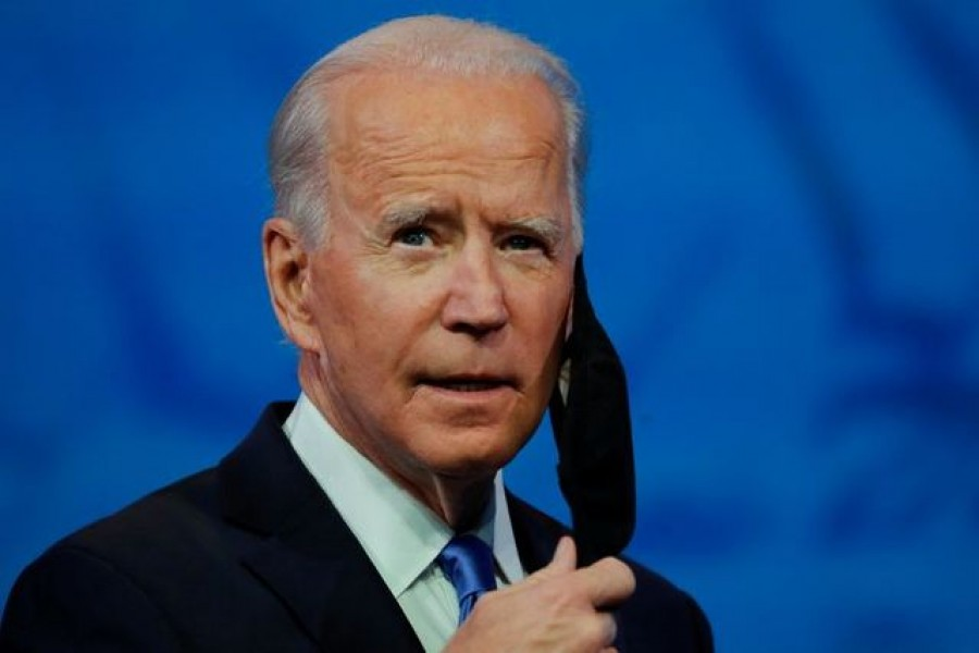 US President-elect Joe Biden takes off his protective face mask to deliver a televised address to the nation, after the US Electoral College formally confirmed his victory over President Donald Trump in the 2020 US presidential election, from Biden's transition headquarters in Wilmington, Delaware, US, December 14, 2020 — Reuters