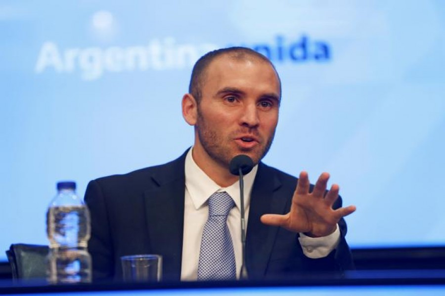 FILE PHOTO: Argentina's Economy Minister Martin Guzman attends a news conference in Buenos Aires, Argentina December 11, 2019. REUTERS/Mariana Greif/File Photo