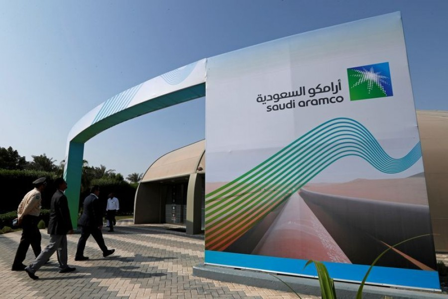 The logo of Aramco is seen as security personnel walk before the start of a press conference by Aramco at the Plaza Conference Center in Dhahran, Saudi Arabia on November 3, 2019 — Reuters/Files