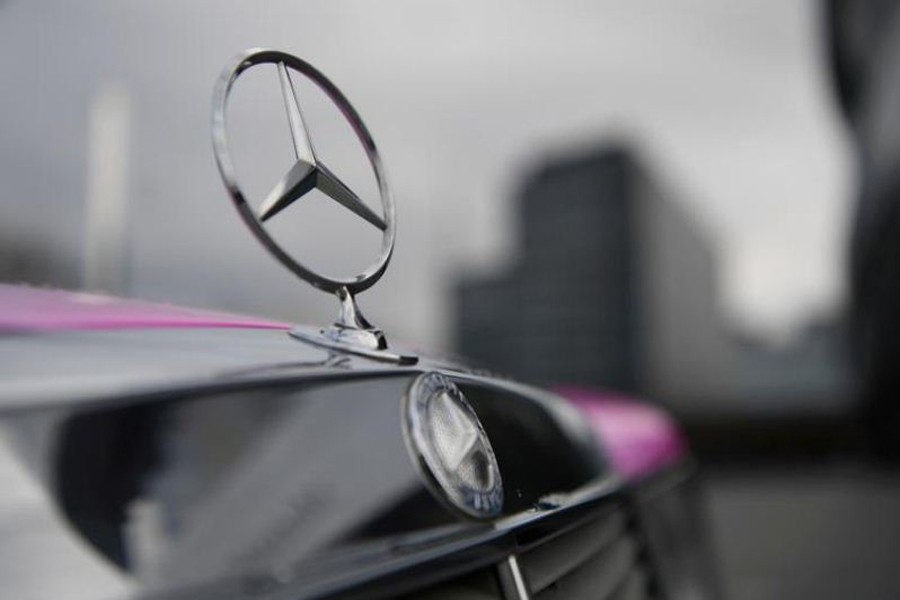 FILE PHOTO: The Mercedes-Benz logo is seen on a car in front of the Mercedes-Benz Museum in Stuttgart, Germany February 11, 2020. REUTERS/Andreas Gebert