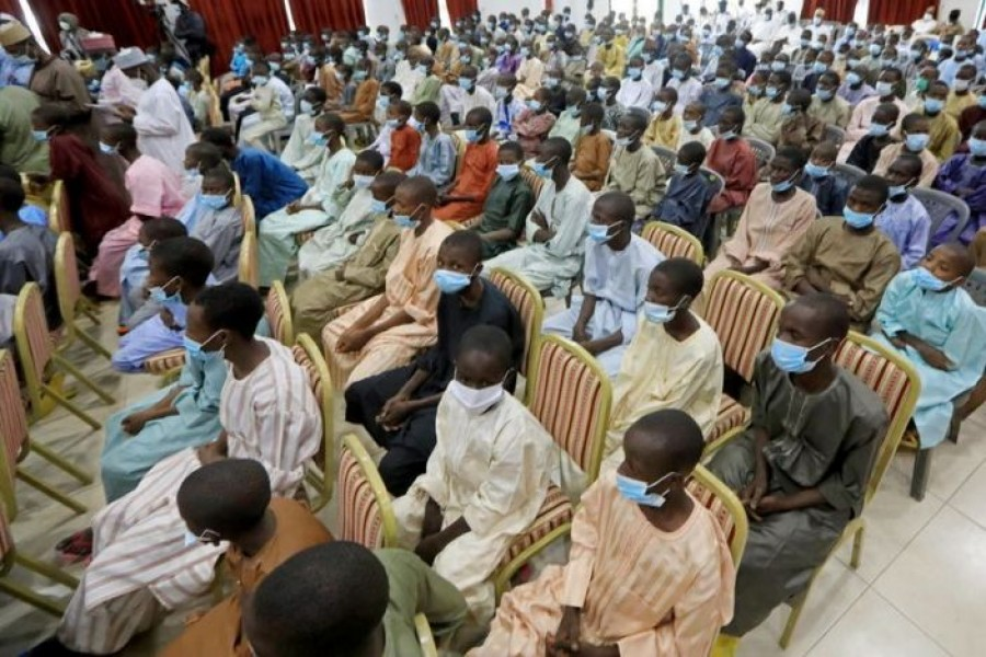 Rescued Nigerian school boys sit together at the Government house in Katsina, Nigeria, December 18, 2020 — Reuters