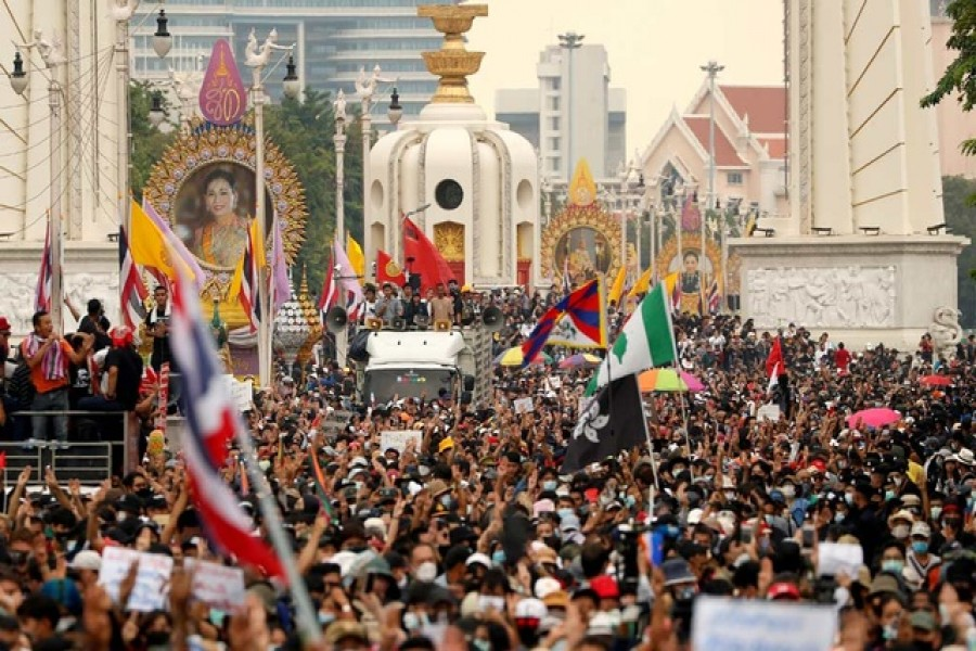 Pro-democracy demonstrators march during a Thai anti-government mass protest, on the 47th anniversary of the 1973 student uprising, in Bangkok, Thailand October 14, 2020. REUTERS