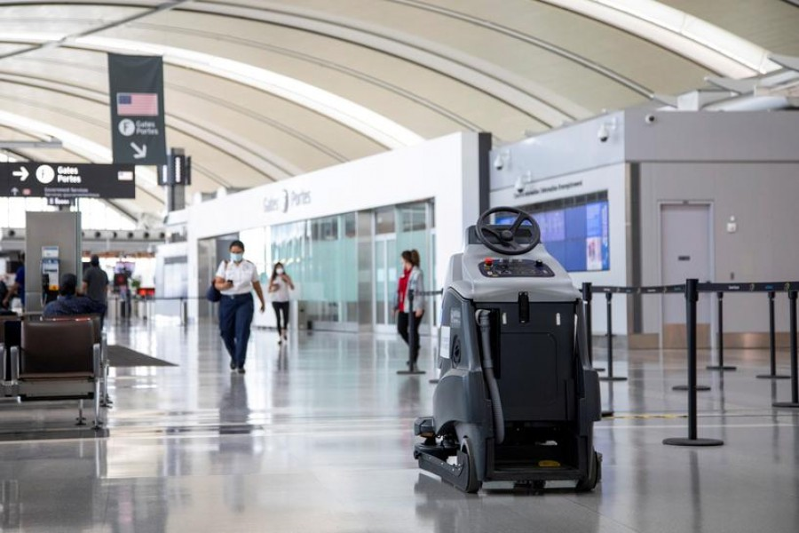 "An autonomous floor cleaning machine cleans terminal 1 as a ""Healthy Airport"" initiative is launched for travel, taking into account social distancing protocols to slow the spread of the coronavirus disease (Covid-19) at Toronto Pearson International Airport in Toronto, Ontario, Canada on June 23, 2020 — Reuters/Files"
