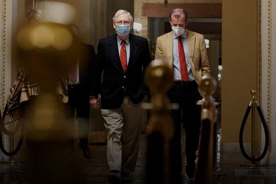 US Sen. Majority Leader Mitch McConnell (R-KY) walks from his office to the Senate floor on Capitol Hill Washington, DC, US on Sunday, December 20, 2020 — Reuters photo