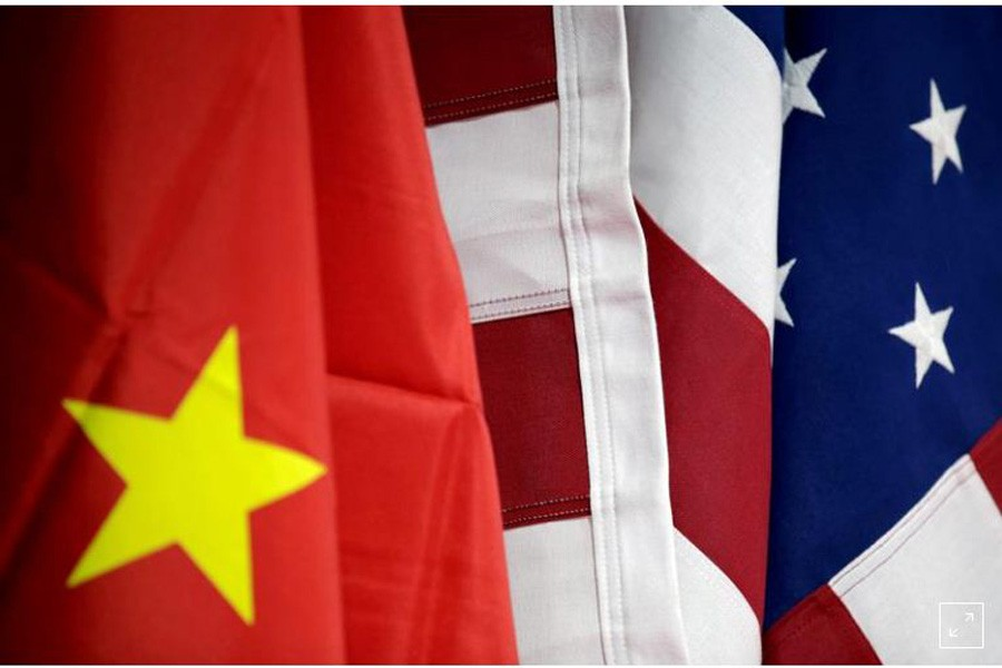 FILE PHOTO: Flags of US and China are displayed at American International Chamber of Commerce (AICC)'s booth during China International Fair for Trade in Services in Beijing, China, May 28, 2019. REUTERS/Jason Lee/File Photo