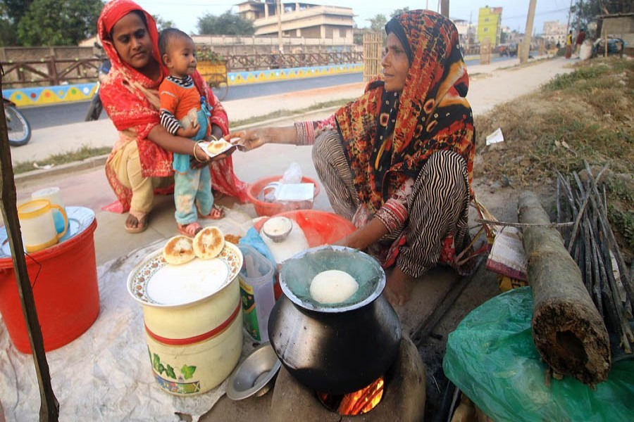 Brisk sales of winter cake of 'vapa pitha' here and there