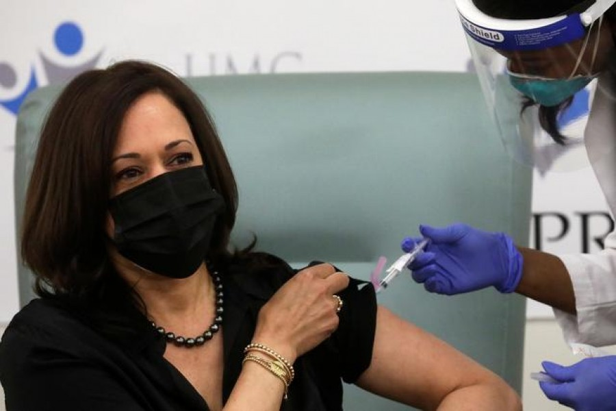 Registered Nurse Patricia Cummings gives US Vice President-elect Kamala Harris a dose of the Moderna Covid-19 vaccine at United Medical Center in Washington, US, December 29, 2020. REUTERS/Leah Millis