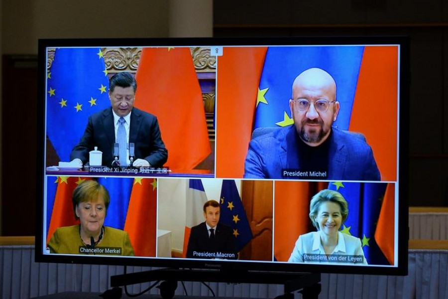 European Commission President Ursula von der Leyen, European Council President Charles Michel, German Chancellor Angela Merkel, French President Emmanuel Macron and Chinese President Xi Jinping are seen on a screen during a video conference, in Brussels, Belgium, December 30, 2020 — Reuters