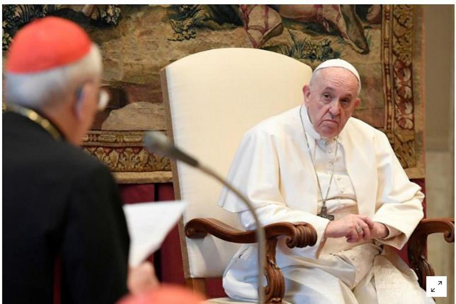 File photo/Reuters: Pope Francis listens during the traditional greetings to the Roman Curia at the Vatican, December 21, 2020