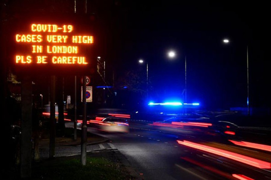 A government public health information message is seen on a roadside sign, amidst the spread of the coronavirus disease (Covid-19) pandemic, in London, Britain on January 4, 2021 — Reuters photo