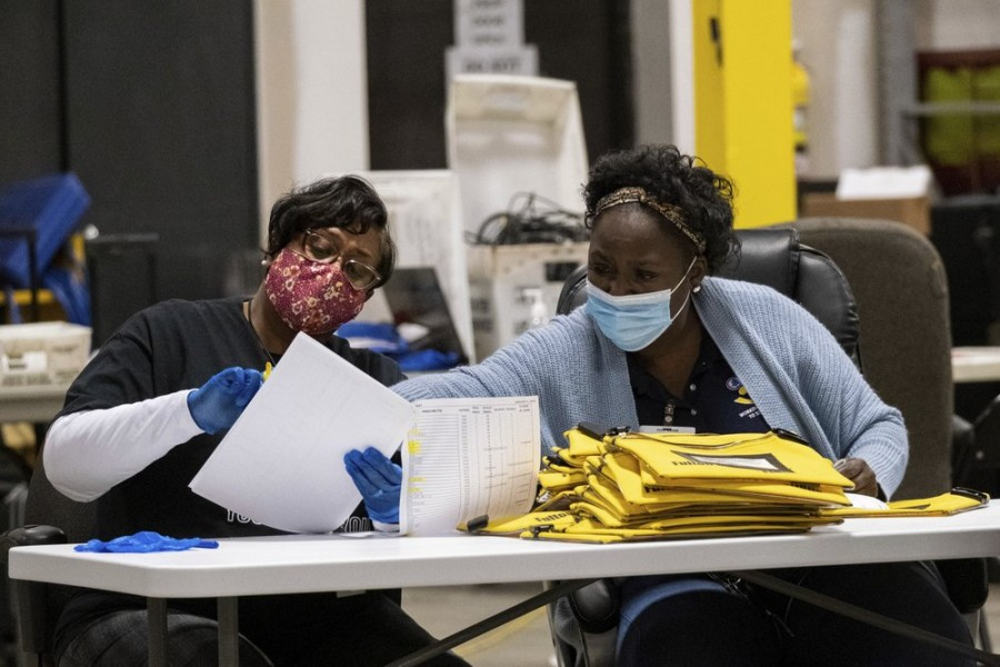 Elections workers at the Fulton County Georgia elections warehouse check in voting machine memory cards that store ballots following the Senate runoff election in Atlanta on Tuesday, Jan. 5, 2021 - AP Photo/Ben Gray