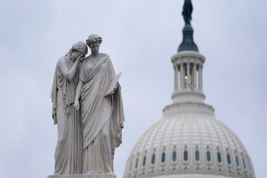 The Peace Monument, also known as the Naval Monument or Civil War Sailors Monument, is framed by the Capitol dome on Capitol Hill in Washington, Monday, Jan 4, 2021. (AP Photo/Susan Walsh)