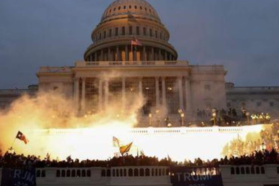 An explosion caused by a police munition is seen while supporters of U.S. President Donald Trump gather in front of the U.S. Capitol Building in Washington, US, January 6, 2021. REUTERS/Leah Millis