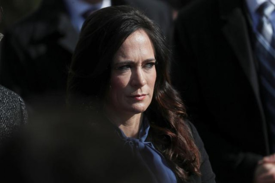 White House Press Secretary Stephanie Grisham listens to US President Donald Trump talk to reporters as he departs for travel to Georgia from the South Lawn of the White House in Washington, US, November 8, 2019. REUTERS/Leah Millis/File Photo