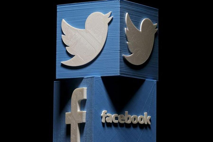 A 3D printed Facebook and Twitter logo seen in the undated Reuters illustration
