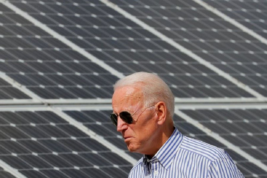 Democratic 2020 US presidential candidate and former Vice President Joe Biden walks past solar panels while touring the Plymouth Area Renewable Energy Initiative in Plymouth, New Hampshire, US, June 4, 2019 — Reuters/Files
