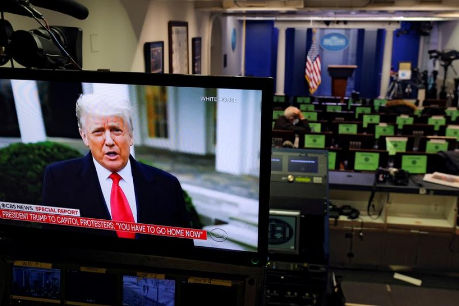 US President Donald Trump is seen making remarks on a television monitor from the White House Briefing Room, after his supporters interrupted the certification by the US Congress of the results of the 2020 US presidential election at the Washington Capitol, in Washington, US, January 6, 2021 — Reuters/Files