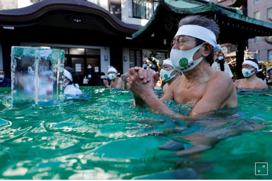 Japanese pray for end to pandemic in annual ice bath ritual