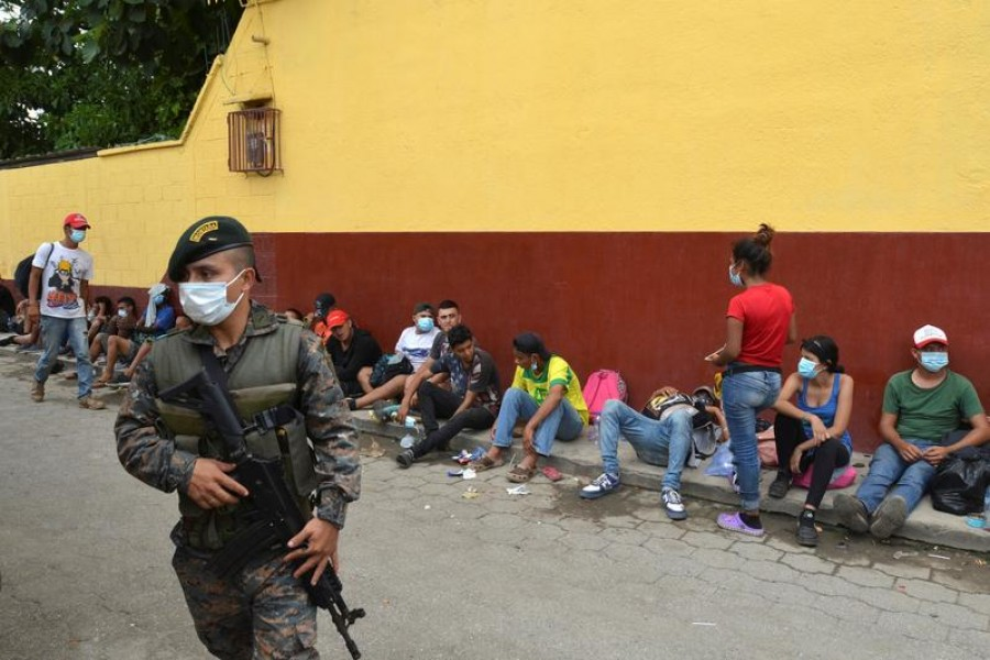 FILE PHOTO: A Guatemalan soldier patrols to prevent a group of Honduran migrants who are trying to reach the US, from moving towards the Guatemala and Mexico border, as they sit outside the migrant shelter, in Tecun Uman, Guatemala October 3, 2020. REUTERS/Jose Torres