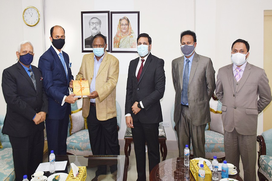 DCCI President Rizwan Rahman, Secretary General Afsarul Arifeen and other officials during a meeting with Commerce Minister Tipu Munshi in the city on Monday