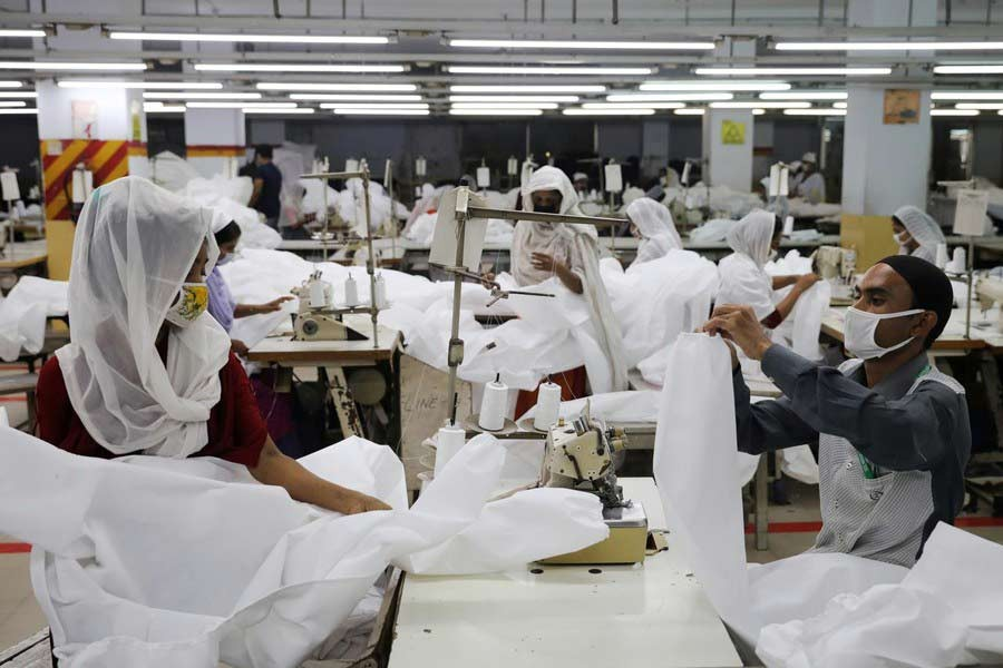 Garment workers making protective suit at a factory in Dhaka amid the coronavirus outbreak —Reuters file photo