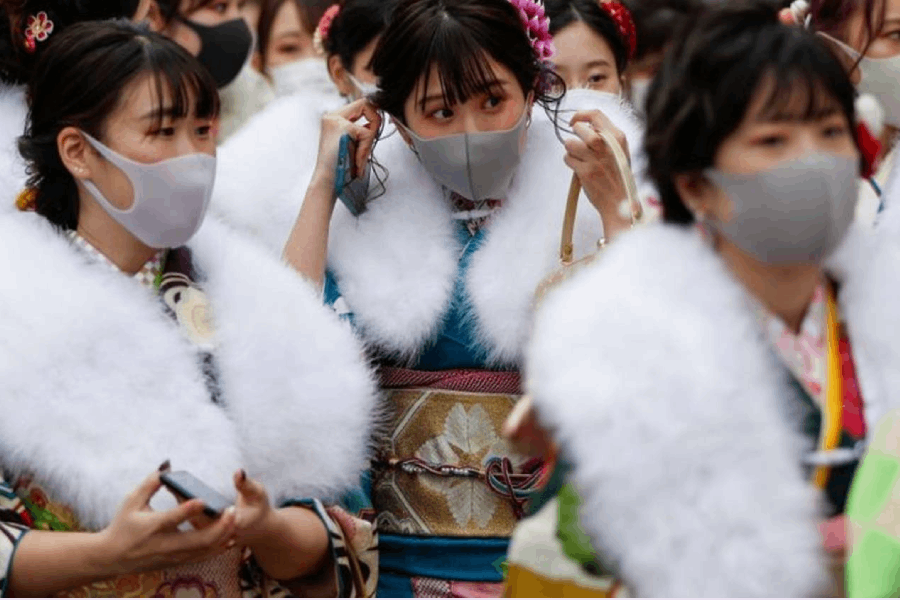 Kimono-clad youth wearing protective face masks leave their Coming of Age Day celebration ceremony at Yokohama Arena during the government declared the second state of emergency for the capital and some prefectures, amid the coronavirus disease (COVID-19) outbreak, in Yokohama, south of Tokyo, Japan January 11, 2021. REUTERS/Issei Kato