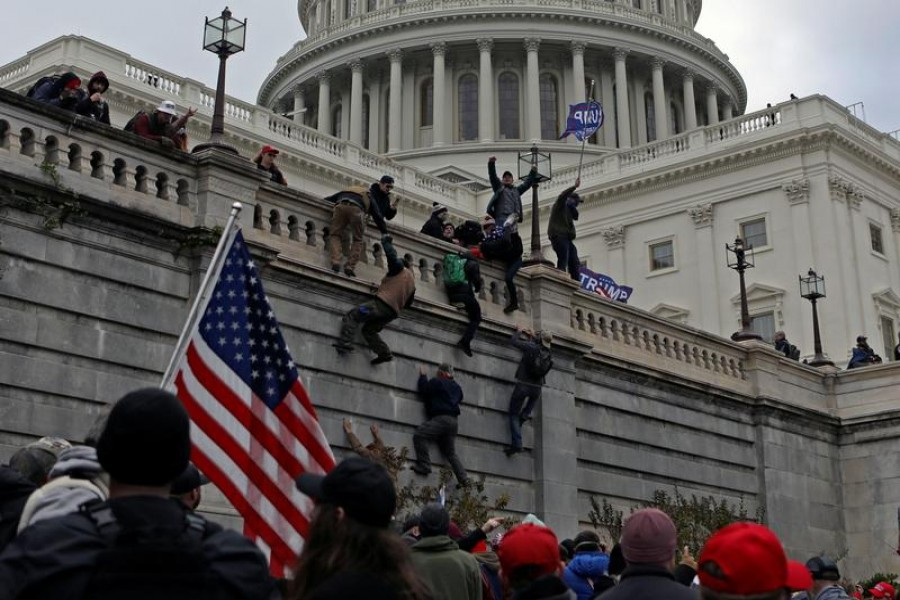 Supporters of US President Donald Trump climb a wall during a protest against the certification of the 2020 presidential election results by the Congress, at the Capitol in Washington, US on January 6, 2021 — Reuters/Files