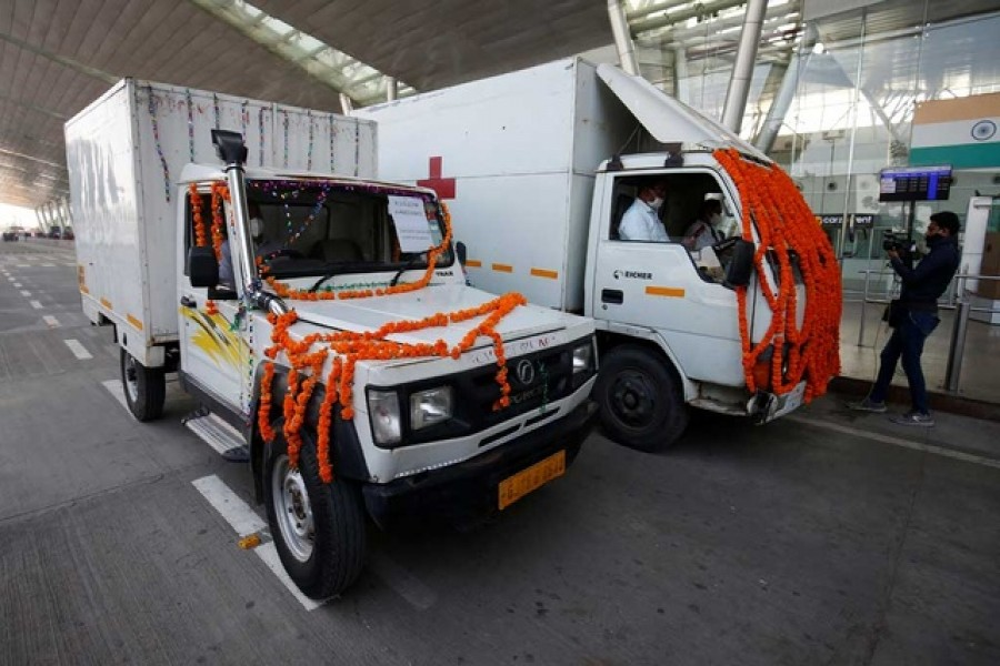 Vehicles containing COVISHIELD, a coronavirus disease (Covid-19) vaccine manufactured by Serum Institute of India, leave the airport after a consignment of the vaccines arrived from the western city of Pune for its distribution, in Ahmedabad, India, January 12, 2021. REUTERS