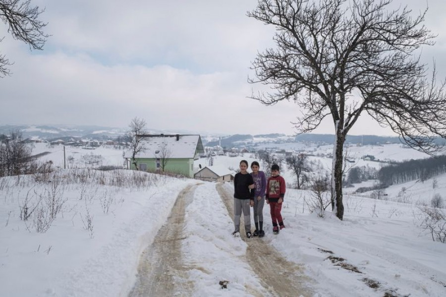 Zeinaf Jabar, a migrant from Iraq, stands with two other kids from Afghanistan near an abandoned house where they live, in the village of Hadzin Potok near the northwestern town of Velika Kladusa, Bosnia and Herzegovina, January 12, 2021 — Reuters photo