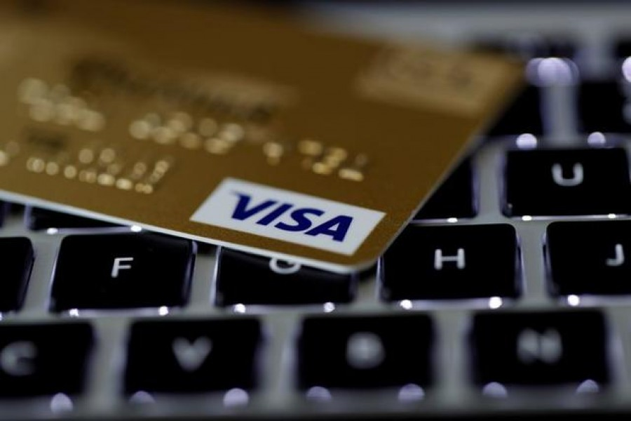 FILE PHOTO: A Visa credit card is seen on a computer keyboard in this picture illustration taken September 6, 2017. REUTERS/Philippe Wojazer/Illustration
