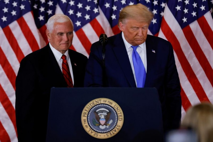 US President Donald Trump and Vice President Mike Pence stand while making remarks about early results from the 2020 US presidential election in the East Room of the White House in Washington, US, November 4, 2020. REUTERS/Carlos Barria/File Photo